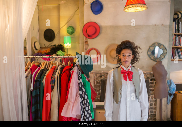 Woman standing in costume shop - Stock Image