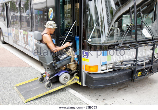 Miami Florida Omni Station Metrobus bus mass transit public transportation man electric wheelchair handicap disabled - Stock Image