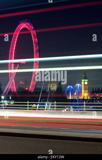 Traffic light trails on Waterloo Bridge with London Eye and Big Ben in the background , London, UK - Stock Image
