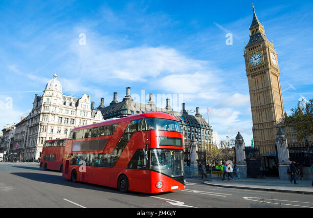 Bright scenic morning view of the London, England skyline at Westminster, with iconic modern double-decker bus passing - Stock Image