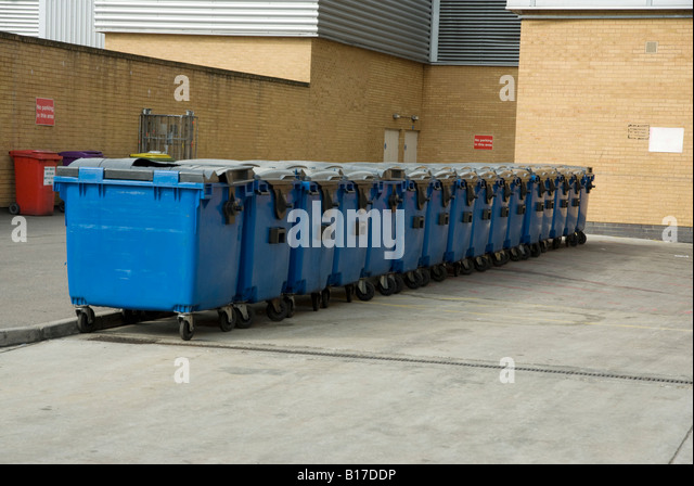 Line of rubbish bins at the back of a supermarket - Stock Image