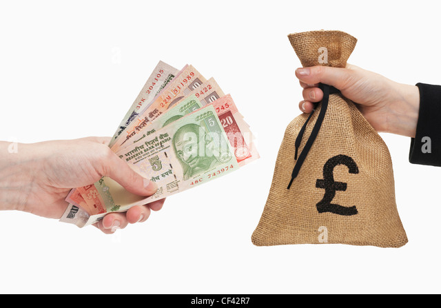 Many diverse Indian rupee bills are held in the hand. At the other side a money bag with Pound currency sign held - Stock-Bilder