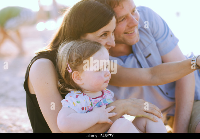 Happy family on the beach - Stock Image