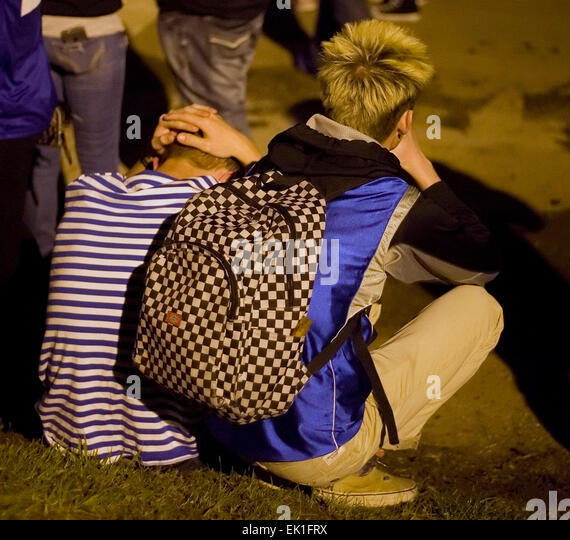 Wisconsin, USA. 05th Apr, 2015. Two University of Kentucky Wildcats fans on State Street react after their team's - Stock Image