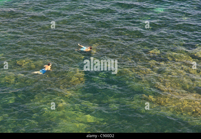 Corfu - two boys swimming in the Ionian sea near the Castle. - Stock Image