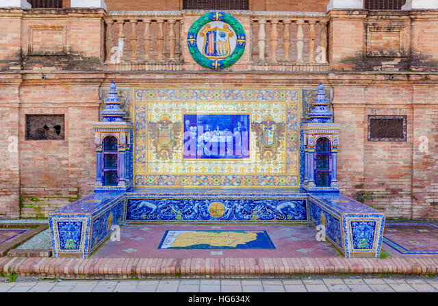 Glazed tiles bench of spanish province of Salamanca at Plaza de Espana, Seville, Spain - Stock Image