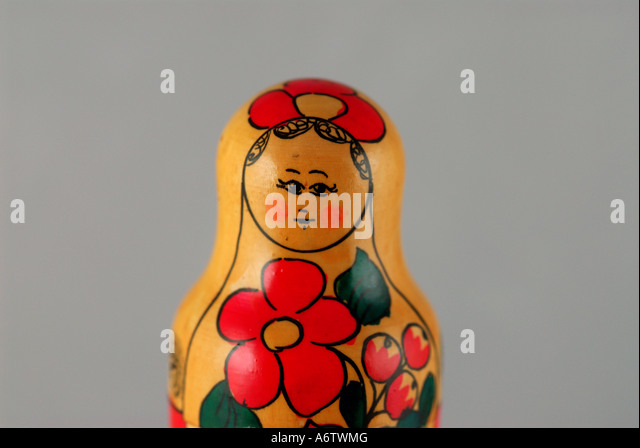 Russian nesting doll red and yellow painted flowers iconic russian souvenir moscow - Stock Image