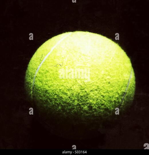 Large yellow tennis ball - Stock Image