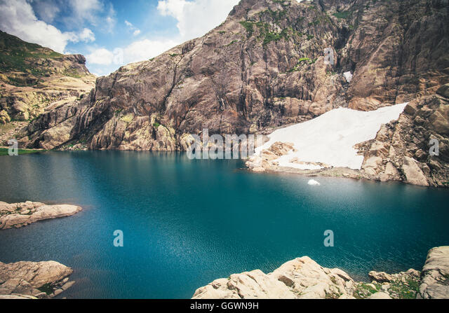 Landscape of blue Lake with Rocky Mountains Summer Travel serene view - Stock Image