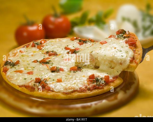 Pizza margharita and slice - Stock Image