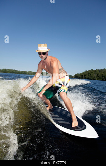 Wakesurfer riding wave - Stock-Bilder