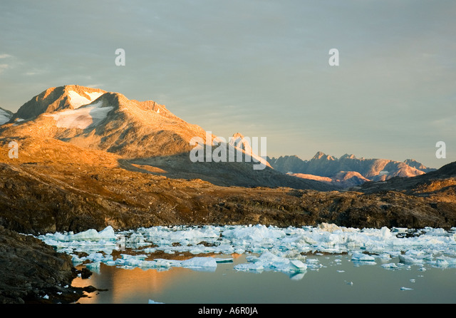 Sunset on the mountains at Paornakajît, Sermilik Fjord, East Greenland - Stock Image