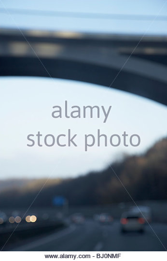 blurred image of bridge over motorway - Stock Image