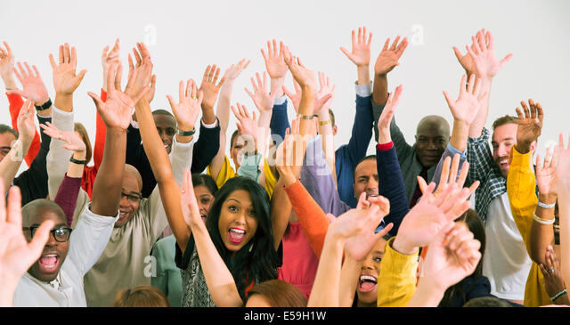 Portrait of diverse crowd cheering - Stock Image