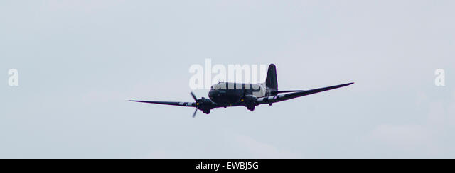 The Douglas C-47 Dakota at RAF Cosford Airshow flyby with crew waving at crowd. - Stock Image