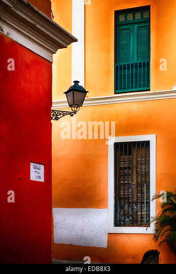 View of a Street Corner with Traditional Pastel Colored Spanish Architecture, Old San Juan, Puerto Rico - Stock Image