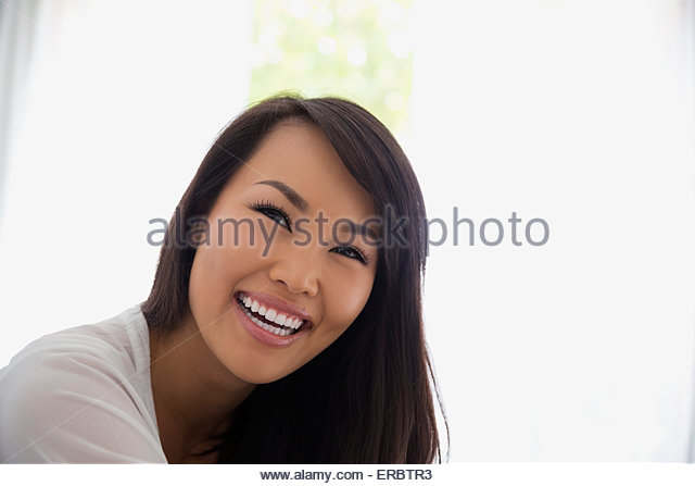 Close up portrait smiling woman black hair - Stock Image