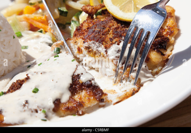 Close up of fried deep sea perch with fragrant rice and cream sauce - Stock Image