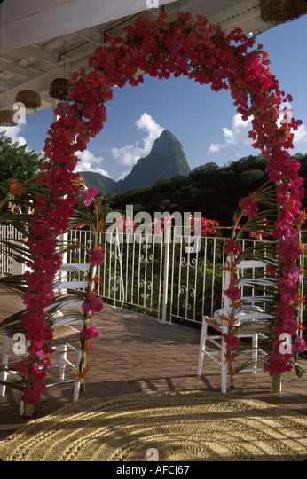 West Indies St. Lucia Anse Chastanet Resort flowers arch wedding bower Petit Piton mountains - Stock Image