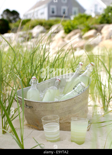 bucket of bottled lemon aide in metal bucket at beach - Stock Image