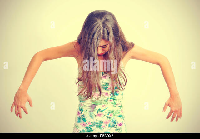 portrait of a young brunette woman performing contemporary dance, with a retro effect - Stock-Bilder