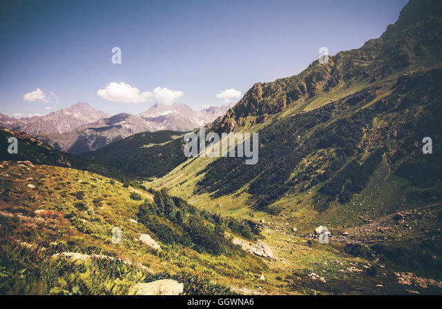 Mountains with green valley and blue sky idyllic Landscape in Abkhazia Summer Travel serene scenic view - Stock Image