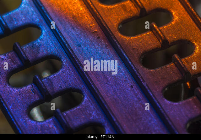 Macro-photo of section of cooling heat-sink from a PC PSU - three IC's or transistors attached out of sight - Stock Image