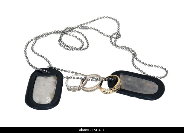 Military dog tags made of metal with a beaded chain with wedding ring - Path included - Stock Image