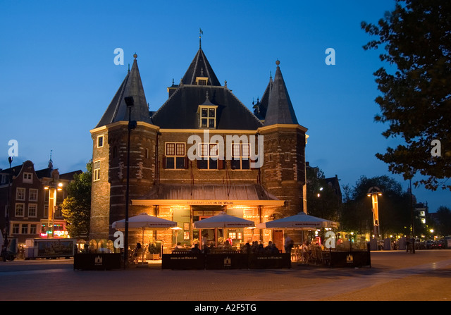 Amsterdam De Waag former weighbridge now Cafe and Restaurant twilight - Stock Image
