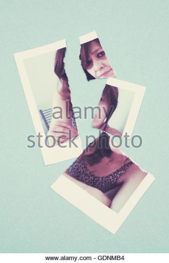 torn photo of a woman - Stock-Bilder