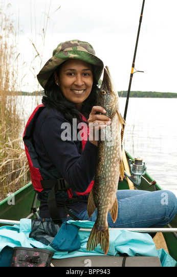 Girl with a northern pike caught in the lake Vansjø in southeastern Norway - Stock Image
