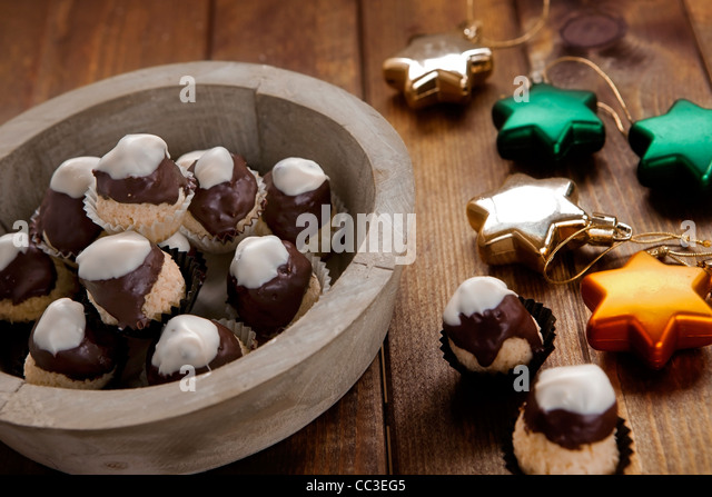 Coconut marzipan mountains with snow-covered Summit - Stock Image
