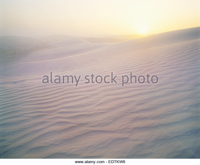 Strong winds over gypsum dunes at sunrise.  White Sands National Monument, New Mexico. - Stock Image