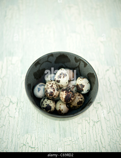 Quails eggs in a bowl - Stock Image