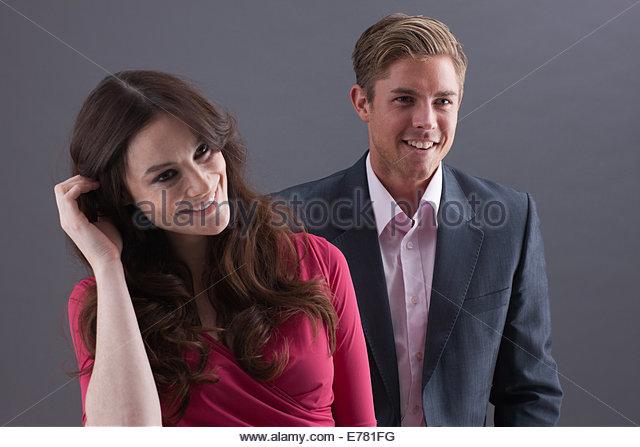 Couple against black background - Stock-Bilder