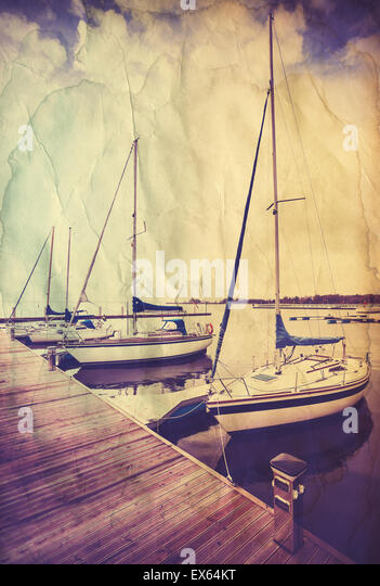 Retro old paper postcard with sailing boats at wooden pier. - Stock-Bilder