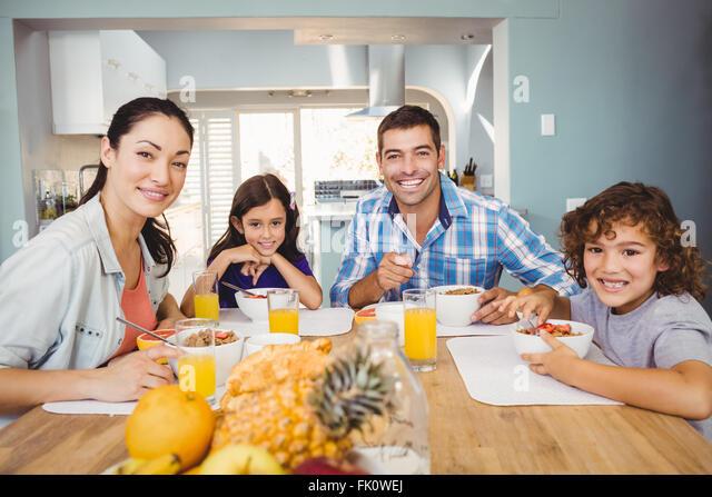 Portrait of happy family having breakfast - Stock-Bilder