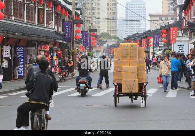 Pedestrians and traffic on Shanghai Old Street, a restored traditional neighbourhood, Nanshi, Shanghai, China, Asia - Stock Image