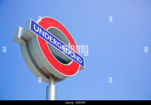 London Underground logo sign against a blue sky - Stock Image