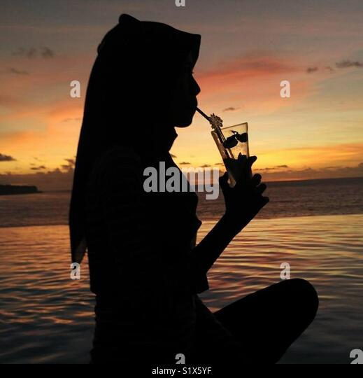 silhouette while sunset in Bali - Stock Image