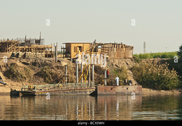 Egypt Kom Ombo Nile River barge and building - Stock Image