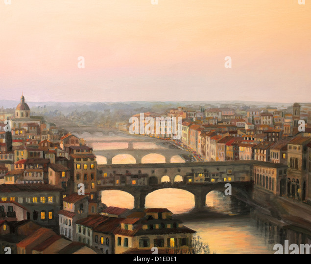 Sunset over Florence with the river and ponte vecchio in warm light. - Stock Image