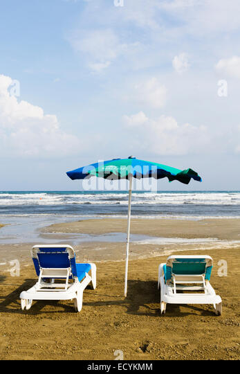 Sunbeds on the beach at Larnaca, Cyprus. - Stock Image