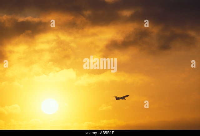 Aircraft in Sky at Sunrise Heathrow England UK - Stock Image