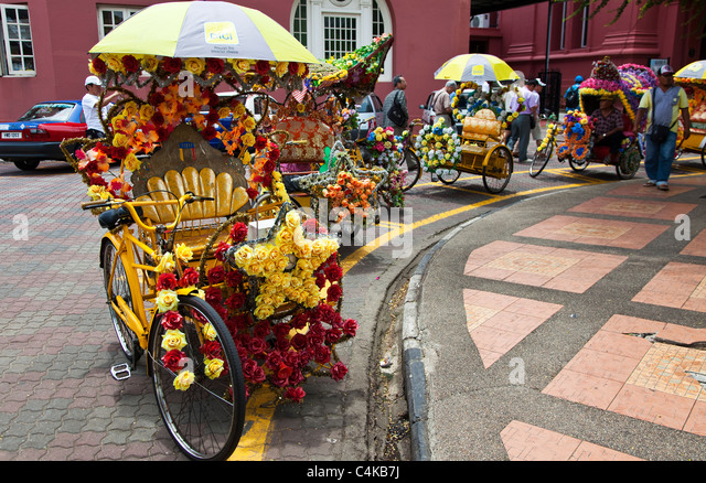 A Colourful Rickshaw in Melaka, Malaysia - Stock Image