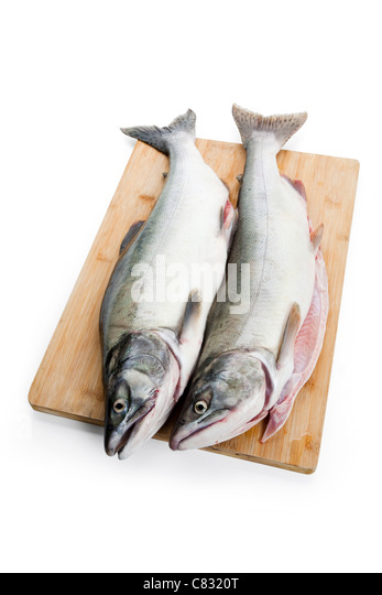 Pink Salmon on cutting board - Stock Image