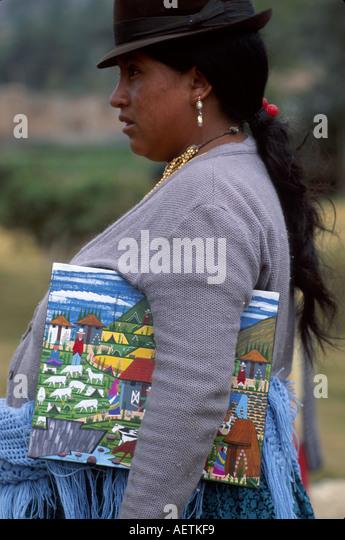 Ecuador Saquisili Market Otavalo Cotopaxi Chibuleos Indigenous natives female art primitive painting canvas hat - Stock Image