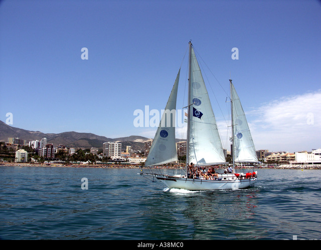 Yacht sailing in the Mediterranean Sea off the coast of Benalmadena, Costa del Sol, Spain - Stock Image