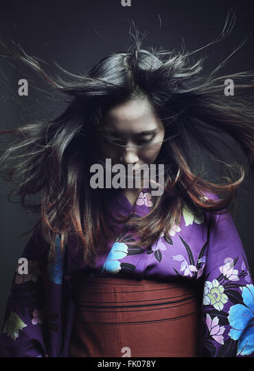 Portrait of a japanese woman with traditional kimono . Studio dark shot - Stock-Bilder