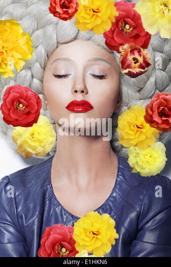 Fantasy. Portrait of Sleeping Woman with Closed Eyes and Colorful Flowers - Stock Image